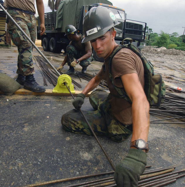 US Navy (USN) SEAMAN Apprentice (SA) Mark West, Naval Mobility Construction Battalion, Port Hueneme, California (CA), cuts rebar for the new Timehri Primary School, during Exercise NEW HORIZONS 2004-Guyana. NEW HORIZONS 2004 - Guyana is a joint service training exercise held in Guyana, South America co-sponsored by both the US Southern Command (USSOUTHCOM) in Miami, Florida (FL), and the Guyana Defense Force (GDF). During this four-month exercise, a combined team of GDF and US military personnel will be engaged in construction projects and medical training activities that directly benefit the local community. The exercise will include up to three construction projects and two Medical...