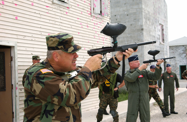 US Army (USA) Major General (MGEN) R. Martin Umbarger, The Adjutant General, Indiana National Guard, takes aim during the 181st Fighter Wing's (FW) 2004 Annual Training at Alpena Combat Readiness Training Center (CRTC). In the background, US Air Force (USAF) Brigadier General (BGEN) Richard H. Clevenger, Commander, Indiana Air National Guard (INANG), also sharpens his shooting skills with the paintball gun