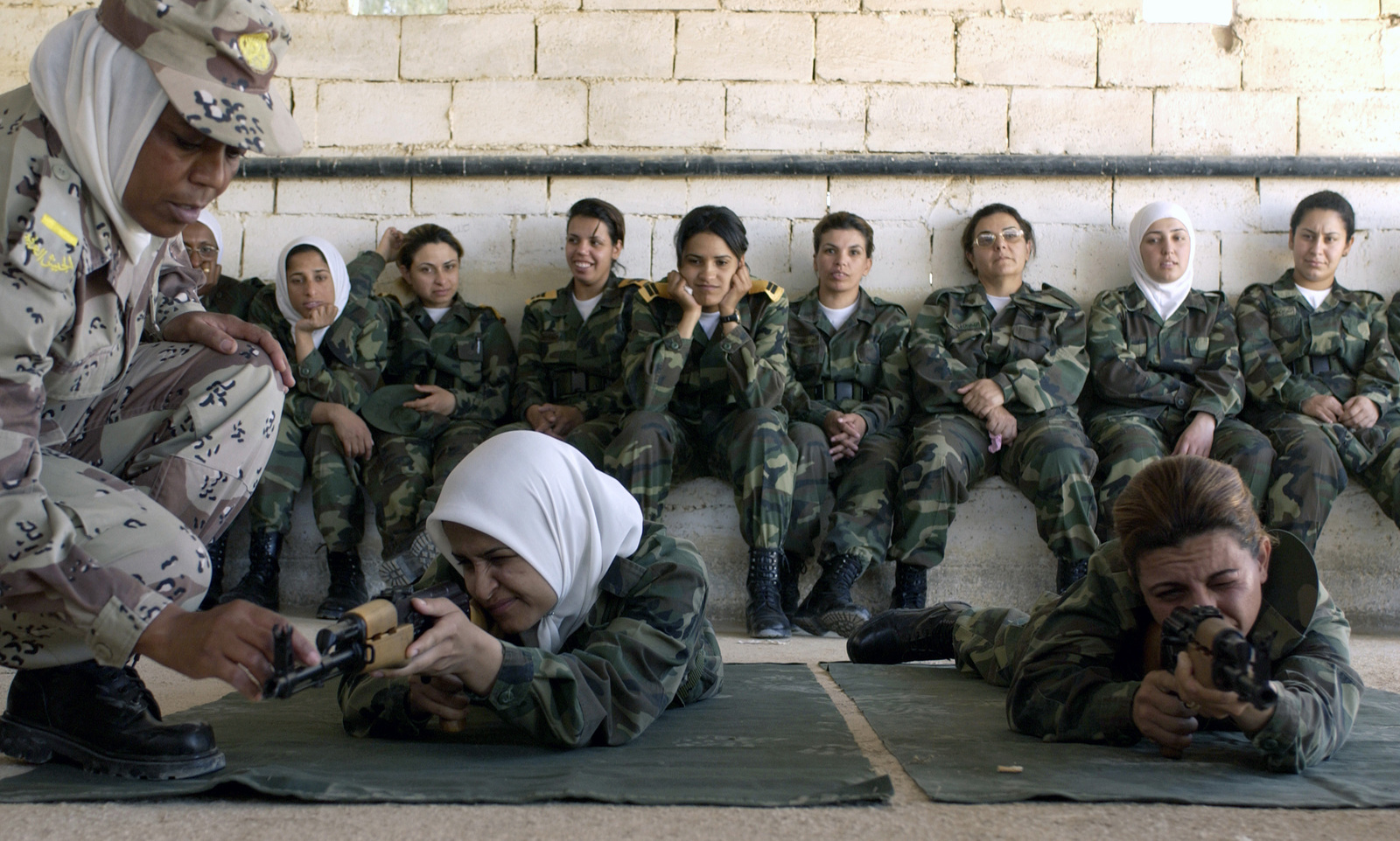 Jordanian Warrant Officer (WO) Emad, instructs trainees from