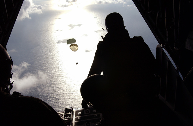 US Air Force (USAF) Pararescuemen from the 38th Rescue Squadron (RS), Moody Air Force Base (AFB) Georgia (GA), jump into the sea 350 miles north east of St. Maarten, from the open cargo ramp of a C-130 Hercules aircraft to provide medical support to a injured Chinese fisherman aboard his boat the Yuh Pao