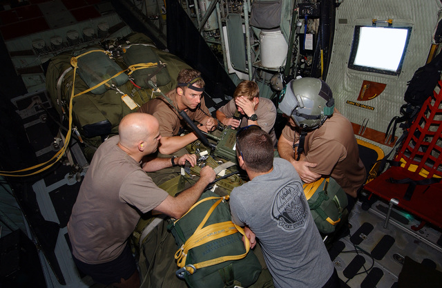 US Air Force (USAF) Pararescuemen from the 38th Rescue Squadron (RS), Moody Air Force Base (AFB) Georgia (GA), go over their mission plans as they are flown 350 miles north east of St. Maarten to provide medical support to a injured Chinese fisherman aboard his boat the Yuh Pao
