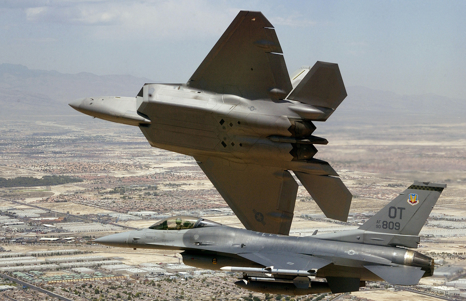 A US Air Force (USAF) F/A-22 Raptor flown by USAF Major (MAJ) David Thole, 422nd Test and Evaluation Squadron (TES), Nellis Air Force Base (AFB), Nevada (NV), breaks away after completing a training mission with a USAF F-16 Fighting Falcon, flown by USAF MAJ Alex Grynkewich, 53rd Test and Evaluation Group (TEG), Nellis AFB, NV