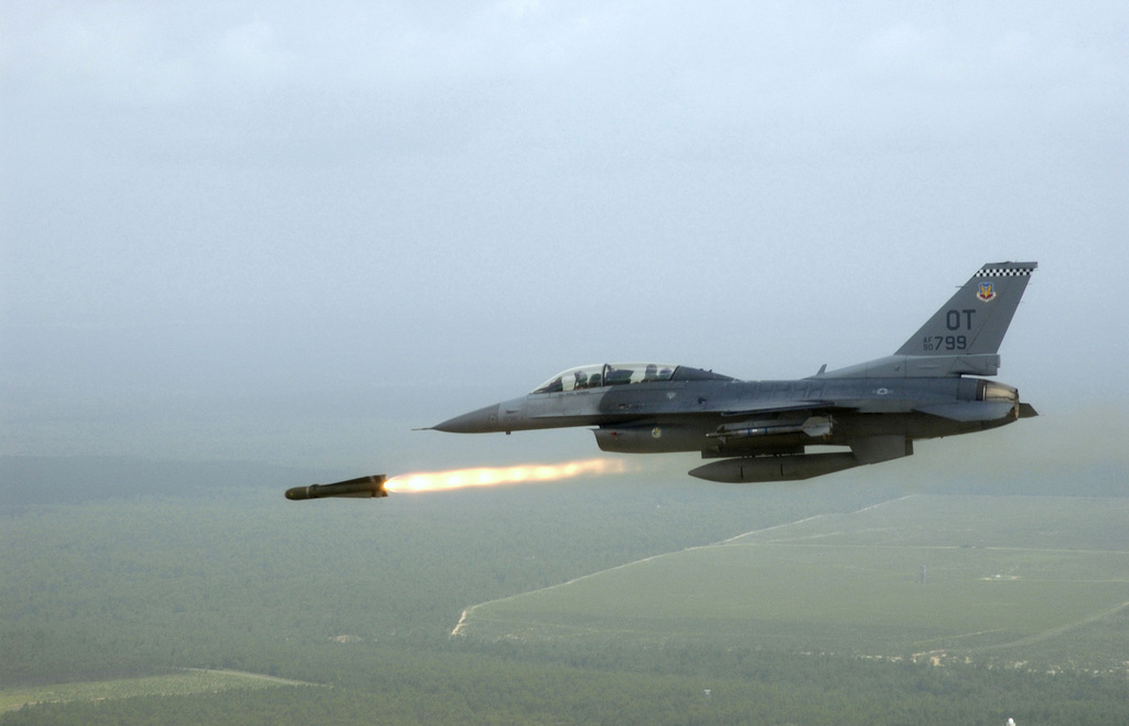 US Air Force (USAF) Captain (CPT) Steven Alexander, Pilot, 85th Test and Evaluation Squadron (TES), Eglin Air Force Base (AFB), Florida (FL), fires an AGM-65 Maverick air-to-ground missile from a USAF F-16 Fighting Falcon fighter at a target on the Eglin land range during an evaluation mission