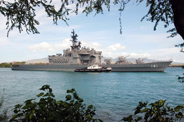 The Japanese Maritime Self-Defense Force (MSDF) Japanese Defense Ship (JDS) Haruna Class Destroyer Haruna (DDH 141) passes Hospital Point in Pearl Harbor, Hawaii, during arrival honors prior to the multinational maritime exercise Rim of the Pacific 2004 (RIMPAC). RIMPAC is the largest international maritime exercise in the waters around the Hawaiian Islands. This years exercise will include eight participating nations; Australia, Canada, Chile, Japan, Peru, South Korea, Britain and the United States. RIMPAC is intended to enhance the tactical proficiency of participating units in a wide array of combined operations at sea, while enhancing stability in the Pacific Rim region
