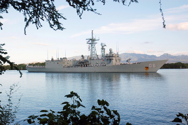 "The Royal Australian Navy (RAN) Adelaide Class Guided Missile Frigate Her Majestys Australian Ship (HMAS) NEWCASTLE (FFG 06), with her Sailors ""manning rails,"" passes Hospital Point in Pearl Harbor, Hawaii, during arrival honors prior to multinational maritime exercise Rim of Pacific (RIMPAC) 2004. RIMPAC is largest international maritime exercise in waters around Hawaiian Islands. This years exercise includes seven participating nations: Australia, Canada, Chile, Japan, South Korea, United Kingdom and United States. RIMPAC enhances tactical proficiency of participating units in a wide array of combined operations at sea, while enhancing stability in..."