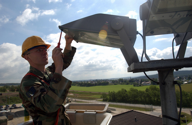 US Air Force (USAF) STAFF Sergeant (SSGT) Mark Jurek, 52nd Civil Engineer Squadron (CES), changes a light bulb on a utility pole in support of Combat Proud at Spangdahlem Air Base (AB), Germany (DEU). Combat Proud is a self-help program to up grade the base appearance
