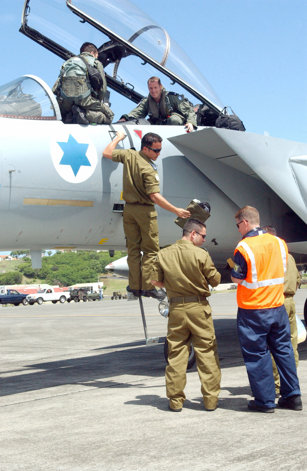 Israeli Air Force And US USAF Crew CHIEF Personnel With The 65th Operations Support Squadron OSS Assist Pilots At Their F 15