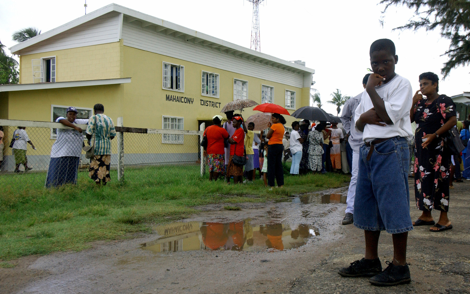 A local boy stares directly at the camera, while standing in line in front of the Mahaicony District Hospital, Mahaicony, Guyana (GUY) during a Medical Readiness Training Exercise (MEDRETE) mission in support of Exercise New Horizons 2004-Guyana. The exercise is co-sponsored by the US Southern Command (SOUTHCOM) and the Guyana (GUY) Defense Force (GDF)