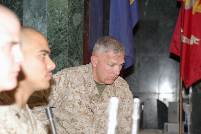 US Marine Corps (USMC) Lieutenant General (LGEN) James T. Conway, Commander of I Marine Expeditionary Force (I MEF), takes a seat after introducing two Representatives from California (CA) and one from Texas (TX). The Representatives are there to talk to US military personnel at Camp Fallujah, Iraq, about what the troops are doing for their country and to give them encouragement during Operation IRAQI FREEDOM