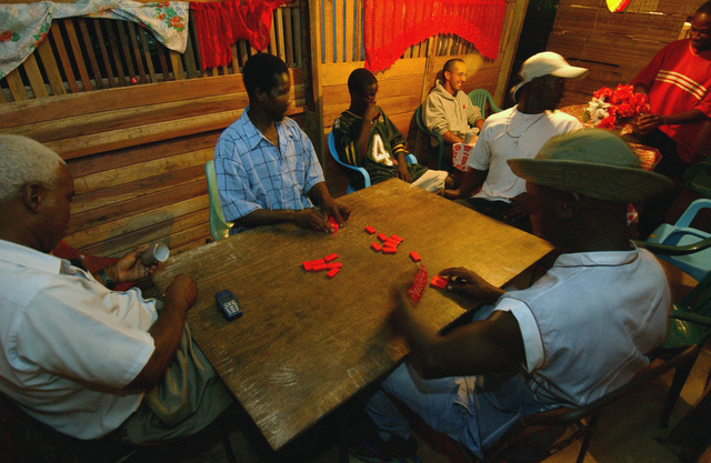 Located out side Camp Stephenson, Timehri, Guyana (GUY), men and women play dominoes at The Shack, a local hang out during exercise New Horizons 2004 Guyana (GUY)