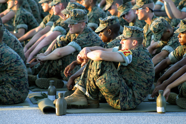 A US Marine Corps (USMC) recruit platoon guide rests on his Iso Mat as he and other recruits are seated and lined up in platoon order during the annual Independence Day celebration at Marine Corps Recruit Depot (MCRD) Parris Island, South Carolina (SC)