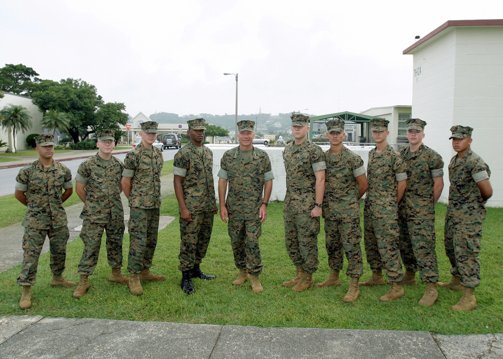 US Marine Corps (USMC) General (GEN) Michael W. Hagee (fifth from left), Commandant of the Marine Corps (CMC) takes time to pose for a group photo with USMC III Marine Expeditionary Force (MEF) Marines outside the Camp Foster theater during his visit to Marine Corps Base (MCB) Camp Smedley D. Butler, Okinawa, Japan