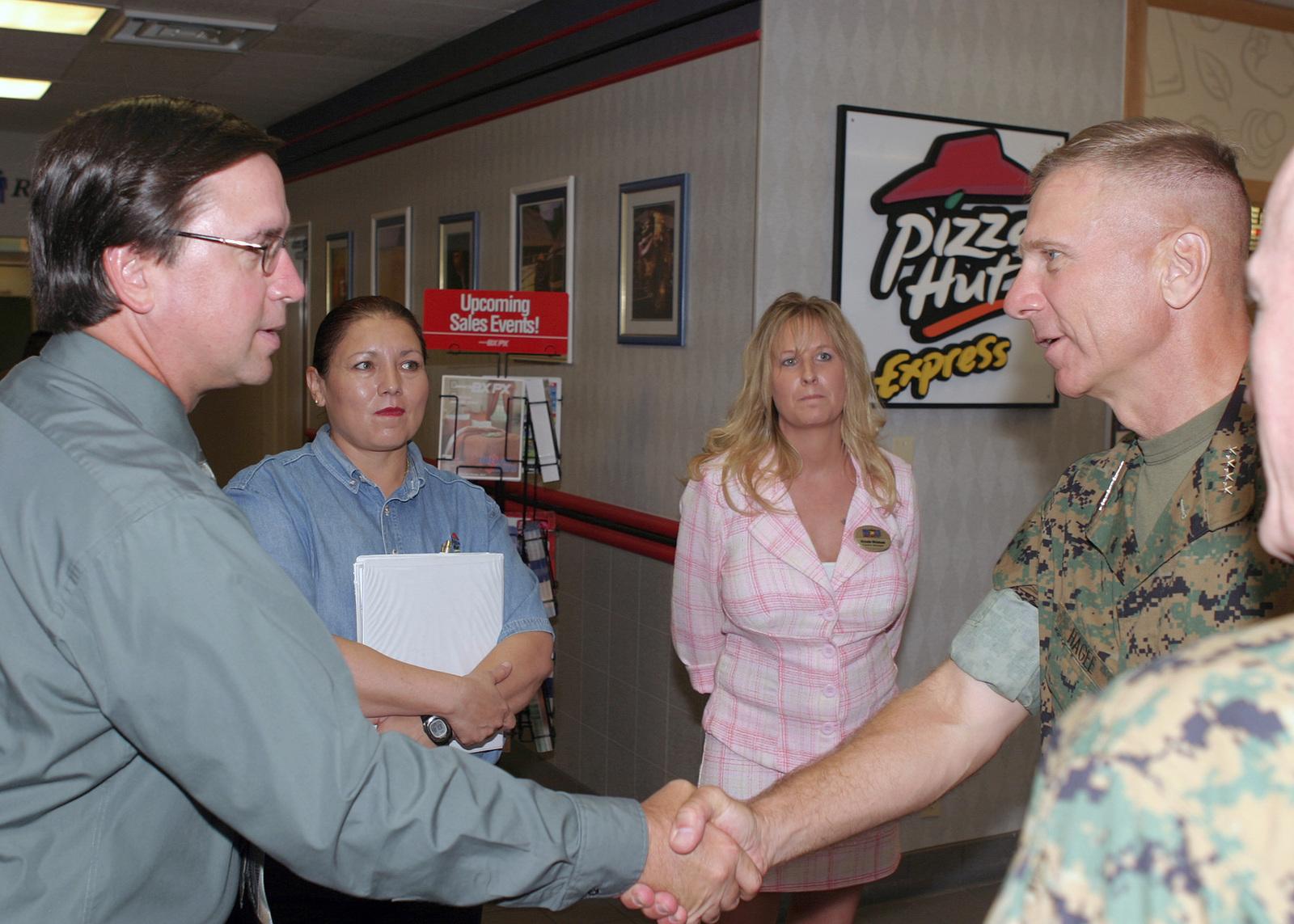 US Marine Corps (USMC) General (GEN) Michael W  Hagee (right