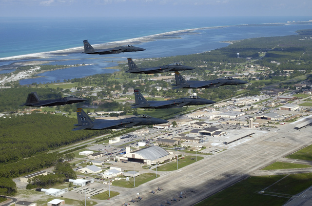 US Air Force (USAF) Brigadier General (BGEN) Larry New, Commander of the 325th Fighter Wing (FW), Air Education and Training Command (AETC) located at Tyndall Air Force Base (AFB), Florida (FL), leads a formation of four F-15C Eagle fighters from the 1ST, 2nd, and 95th Fighter Squadrons (FS) and one F/A-22 Raptor (left) from the 43rd FS, each flown by their respective Squadron Commander