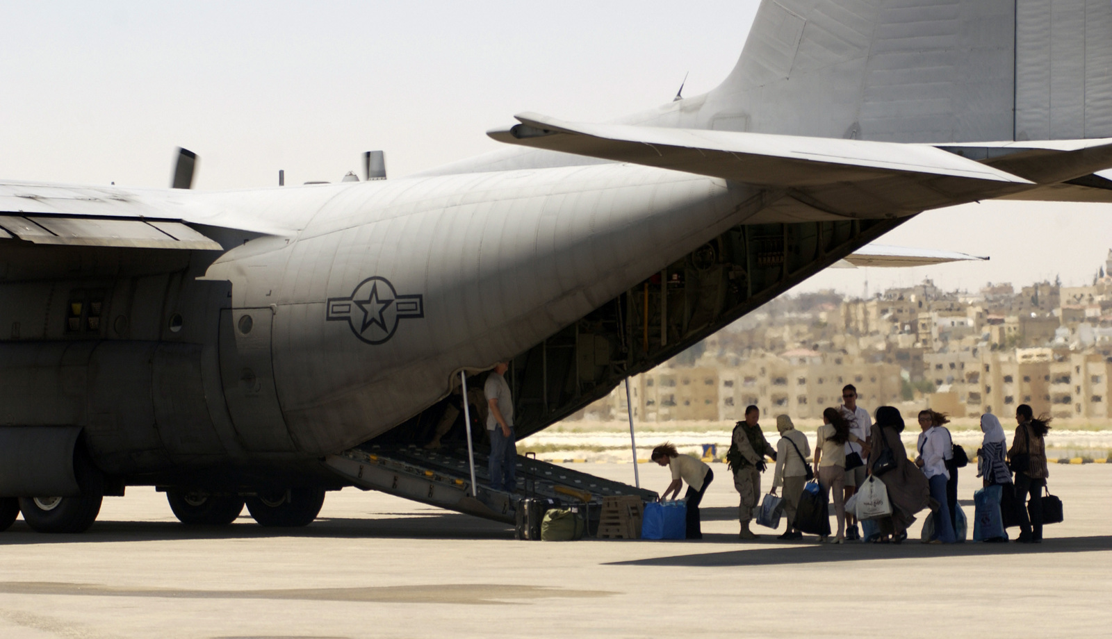 Jordanian Female Recruits for the Iraqi Army, board a US Air Force (USAF) C-130 Hercules aircraft at Amman, Jordan, enroute to Baghdad, Iraq, where they will report for duty in the New Iraqi Army (NIA)