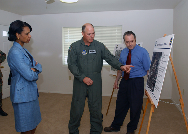 National Security Advisor, Dr. Condoleezza Rice (left), is briefed on the progress of the housing project at Elmendorf Air Force Base (AFB), Alaska (AK), by US Air Force (USAF) Colonel (COL) James Sturch, Vice-Commander, 3rd Wing (WG), and Mr. Ted Franklin, CHIEF of Privatized Housing at Elmendorf