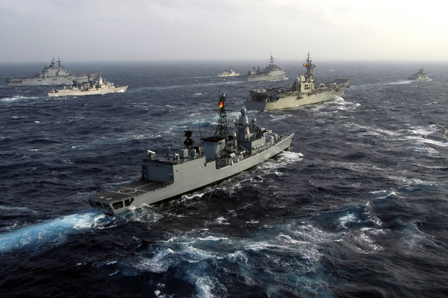 A multi-national armada of war ships underway in the Atlantic Ocean while participating in Exercise MAJESTIC EAGLE 2004. Pictured clockwise, the German Navy, BREMEN CLASSS (Type 122): Frigate, NIEDERSACHSEN (F 208), the Royal Netherlands Navy Frigate, Hr Ms JACOB VAN HEEMSKERCK (F 812), the Italian Navy, GARIBALDI CLASS: Aircraft Carrier, GIUSEPPE GARIBALDI (C 551), the Moroccan Navy MODIFIED DESCUBIERTA CLASS: Frigate, LIEUTENANT COLONEL ERRHAMANI (FFG 501), the US Navy (USN) CONVERTED RALEIGH CLASS: Miscellaneous Command Ship, USS LA SALLE (AGF 3), and the Spanish Navy Aircraft Carrier, PRINCIPE DE ASTRUIAS (R 11). The exercise demonstrates the combined force capabilities and quick...