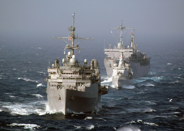 Bow on view showing three multi-national war ships underway in the Atlantic Ocean, while participating in Exercise MAJESTIC EAGLE 2004. Pictured foreground-to-background are the US Navy (USN) CONVERTED RALEIGH CLASS: Miscellaneous Command Ship, USS LA SALLE (AGF 3), the Royal Netherlands Navy Frigate, Hr Ms JACOB VAN HEEMSKERCK (F 812), and the USN Submarine Tender, USS EMORY S. LAND (AS 39). The exercise demonstrates the combined force capabilities and quick response times of the participating naval, air, undersea and surface warfare groups