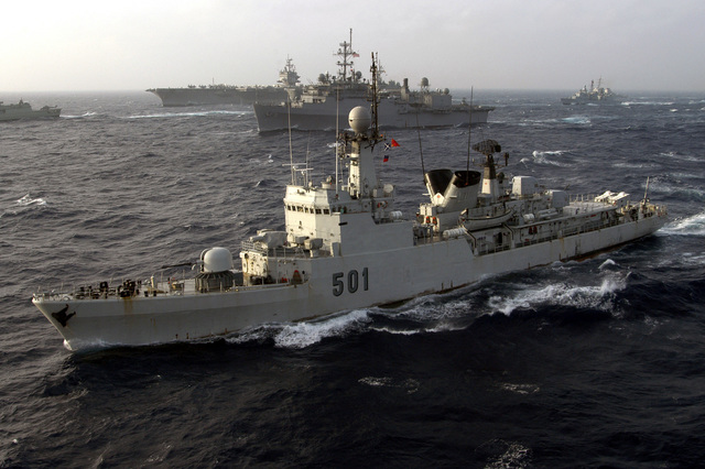 The Moroccan Navy MODIFIED DESCUBIERTA CLASS: Frigate, LIEUTENANT COLONEL ERRHAMANI (FFG 501) (foreground), underway in the Atlantic Ocean with the US Navy (USN) CONVERTED RALEIGH CLASS: Miscellaneous Command Ship, USS LA SALLE (AGF 3) (center), the USN Aircraft Carrier, USS ENTERPRISE (CVN 65), and the German Navy, BREMEN CLASSS (Type 122): Frigate, NIEDERSACHSEN (F 208) (background right), while participating in Exercise MAJESTIC EAGLE 2004. The exercise demonstrates the combined force capabilities and quick response times of the participating naval, air, undersea and surface warfare groups