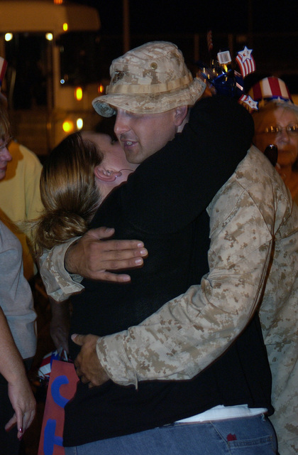 US Marine Corps (USMC) Lance Corporal (LCPL) Chris Riggs, assigned to Battalion (BN), 4th Marines, Lima Company, is greeted by his wife, Vanessa Riggs, as he returns from an 8 month tour in support of Operation IRAQI FREEDOM