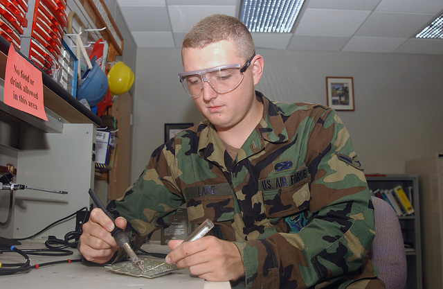 US Air Force (USAF) AIRMAN 1ST Class (A1C) Samuel Lake, solders motherboard wires together on a radio transmitter. A1C Lake is currently a Ground Radio Technician with the 509th Communications Squadron (CS), at Whiteman Air Force Base (AFB), Missouri (MO)