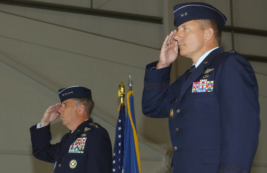 "During the US Air Force (USAF) 3rd Air Force assumption of command ceremony in hangar 814, Royal Air Force (RAF) Mildenhall, England (ENG), Commander US Air Force in Europe (USAFE) General (GEN) Robert H. ""Doc"" Foglesong (left) and Major General (MGEN) Michael Gould, salute during the national anthem"