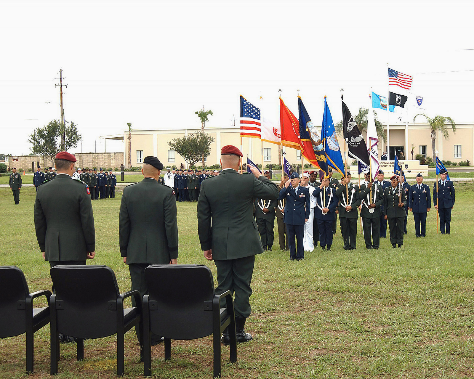 US Army (USA) Colonel (COL) James A. Lien (right), outgoing Commander, Joint Communications Support Element (JCSE), drops his salute to US Air Force (USAF) Lieutenant Colonel (LTC) Kenneth A. Gaines (USAF officer saluting in background), Deputy Commander, JCSE, during the JCSE Change of Command ceremony at MacDill Air Force Base (AFB), Florida (FL). Standing at attention observing this exchange of salutes are USA COL Thomas G. Hopkins (left), incoming Commander, JCSE, and USA Lieutenant General (LGEN) Robert W. Wagner (center), Deputy Commander, US Joint Forces Command (JFC), and change of command presiding officer