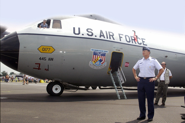 US Air Force (USAF) General (GEN) Gregory S. Martin (right), Commander, Air Force Material Command (AFMC), Wright-Patterson (W-P) Air Force Base (AFB), Ohio (OH), stands in front of the Hanoi Taxi, a USAF C-141B Starlifter cargo aircraft (tail number 0177), at the 2004 Dayton Air Show in Dayton, OH