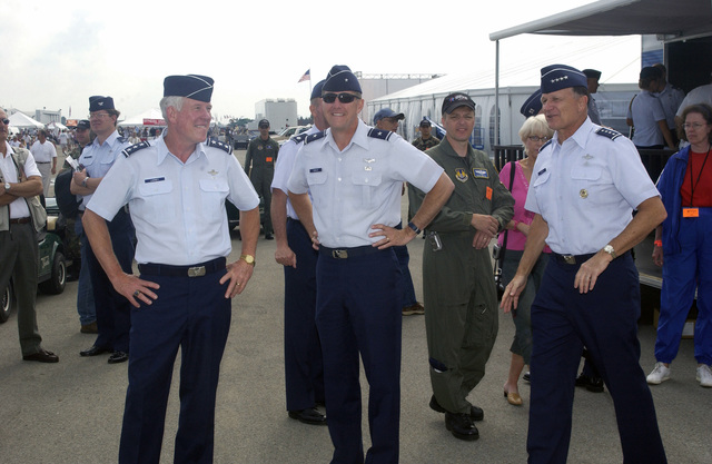 US Air Force (USAF) Lieutenant General (LGEN) William R. Looney, III (left), Commander, Aeronautical Systems Center (ASC), Wright-Patterson (W-P) Air Force Base (AFB), Ohio (OH); Brigadier General (BGEN) Ted F. Bowlds (center), Deputy for Acquisition, ASC, W-P AFB, OH; and General (GEN) Gregory S. Martin (right), Commander, Air Force Material Command (AFMC), W-P AFB, OH, all are in attendance at the 2004 Dayton Air Show in Dayton, OH