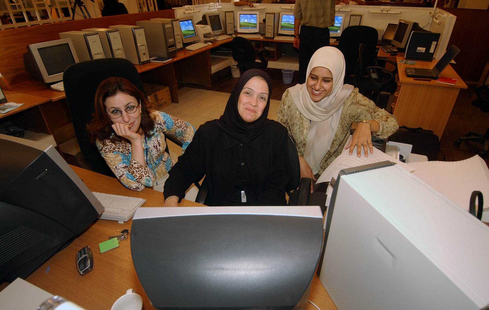 Three Female Employees Of The Iraq Stock Exchange Isx Pose For A Candid Photograph While
