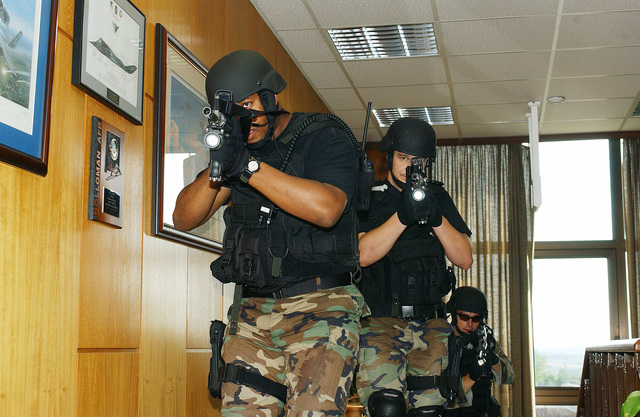 US Air Force (USAF) STAFF Sergeant (SSGT) Timothy Stewart (front), USAF SSGT Brian Little (center), and USAF Captain (CPT) Steven Stone (back), all with the 52nd Security Forces Squadron (SFS) Emergency Services Team (EST), practice clearing a room during a training scenario on Spangdalem Air Base (AB), Rhineland-Pfalz, Germany (DEU)
