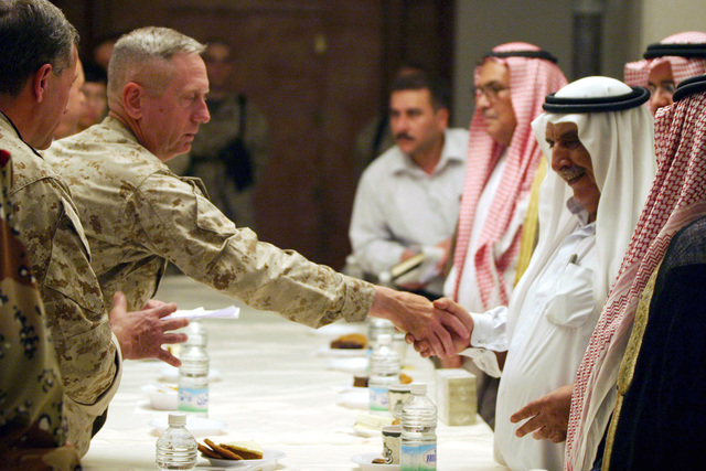 Sheik Amer Sulaym shakes hands with US Marine Corps (USMC) Major General (MGEN) James N. Mattis (left), Commanding General, 1ST Marine Division (MAR DIV), after he and local sheiks met with him and the Governor of Al Anbar province. The meeting is being held at the 1ST MAR DIV Headquarters (HQ) building on Forward Operating Base (FOB) Blue Diamond, in Ar Ramadi, Iraq (IRQ).  1ST MAR DIV, in support of Operation IRAQI FREEDOM, is engaged in Security and Stabilization Operations (SASO) in the Al Anbar province of Iraq