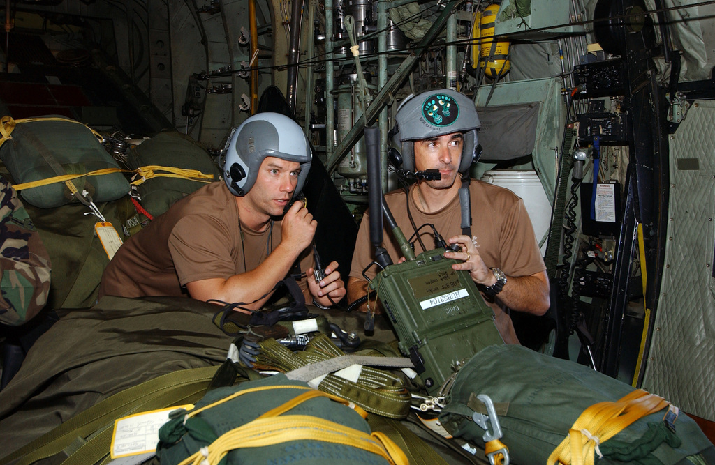 Two US Air Force (USAF) 38th Rescue Squadron (RQS), 347th Rescue Wing (RW), Pararescuemen, from Moody Air Force Base (AFB), Georgia (GA), check their gear, as they review their mission plans seated on a Rigging Alternate Method Zodiac (RAMZ) boat, as they fly onboard a USAF HC-130P/N Hercules extended-range, combat search and rescue aircraft to provide medical support to a Chinese fisherman, aboard the fishing vessel the YUH PAO, who is suffering from a serious chest injury