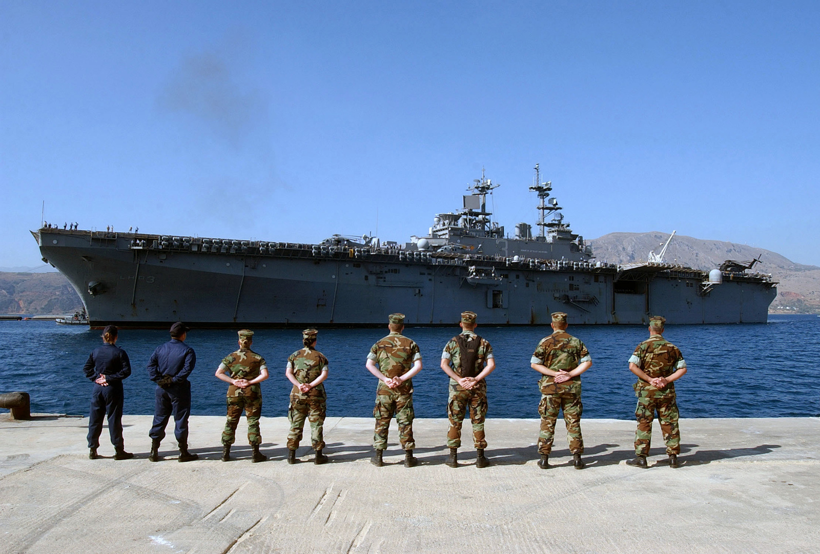 US Navy (USN) volunteer linehandlers, from Naval Station Activity (NSA) Souda Bay, wait on the pier