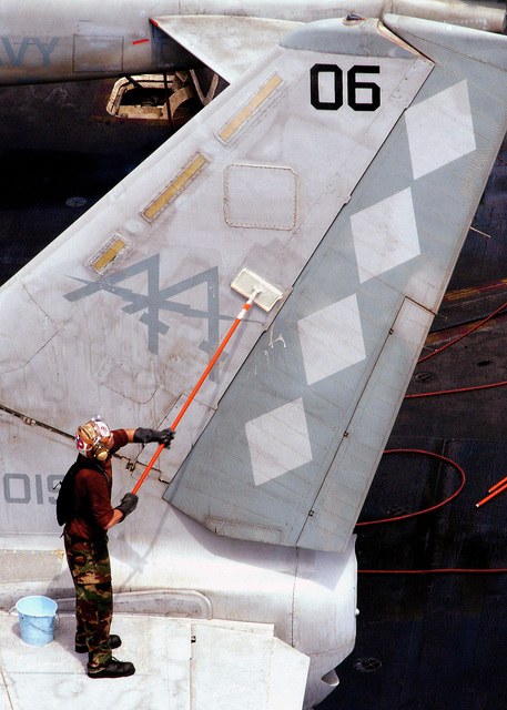 A US Navy (USN) Sailor assigned to the Sea Control Squadron 30 (VS-30), DiamondCutters, Naval Air Station Jacksonville, Florida (FL), scrubs the vertical stabilizer of a USN S-3B Viking, during an aircraft wash on the flight deck onboard the USN Aircraft Carrier USS JOHN F. KENNEDY (CV 67) on the Persian Gulf. The JFK is one of seven carrier strike groups (CSG) involved in SUMMER PULSE 2004. SUMMER PULSE 2004 is the deployment of seven carrier strike groups (CSG), demonstrating the ability of the Navy to provide credible combat capability across the globe, in five theaters with other US, allied, and coalition military forces. SUMMER PULSE is the Navy's first deployment under its new...