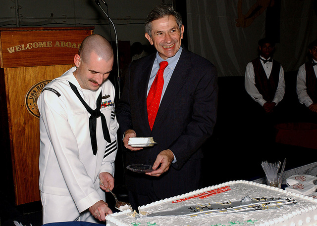 The Honorable Paul D. Wolfowitz, Deputy Secretary of Defense (DEPSECDEF), ceremoniously cuts a cake with US Navy (USN) Electronics Technician First Class (ET1) Bruce Burley after a group reenlistment of 39 Sailors onboard the USN Nimitz Class Aircraft Carrier USS RONALD REAGAN (CVN 76). Mr. Paul Wolfowitz is visiting during REAGAN's homecoming ceremony. The carrier arrived at its new homeport of Naval Air Station North Island (NASNI), San Diego, California (CA), after participating in exercises in support of SUMMER PULSE 2004 with South American Naval forces