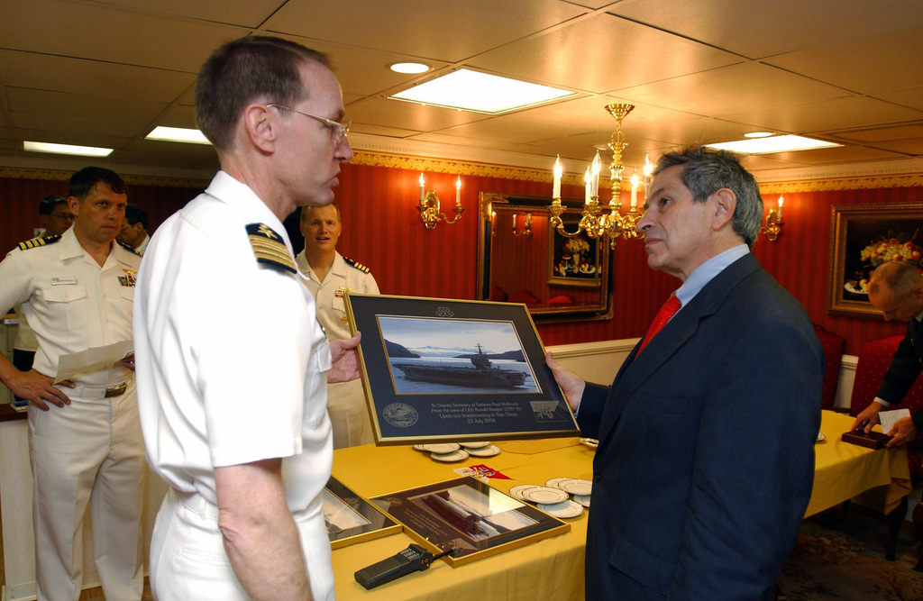 US Navy (USN) Captain (CAPT) Jim Symonds, Commanding Officer (CO), of the Nimitz Class Aircraft Carrier USS RONALD REAGAN (CVN 76), presents the Honorable Paul D. Wolfowitz, Deputy Secretary of Defense (DEPSECDEF), a photograph of the REAGAN during her recent transit through the Straits of Magellan, while underway for her new homeport in San Diego, California (CA). Mr. Wolfowitz is on board the REAGAN to participate in the home porting ceremony at Naval Air Station North Island (NASNI), San Diego, CA