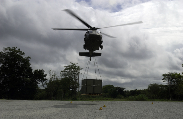 A Colorado Army National Guard (COARNG) 2nd Battalion (BN), 135th Aviation Regiment (2/135th) UH-60 Blackhawk (Black Hawk) utility helicopter lifts a sling loaded Container Express (CONEX) pallet of medical supplies to be transported to New Amsterdam, Berbice District, Guyana (GUY), from Camp Stephenson, Timehri, East Bank Demerara (EBD) District, GUY, as part of a Operation NEW HORIZONS 2004. This operation is a four-month joint service training exercise being held in Guyana by elements of the US Southern Command (USSOUTHCOM) and the Guyana Defense Force (GDF), and it involves combined teams of US and GDF military personnel working on several construction projects and two Medical...