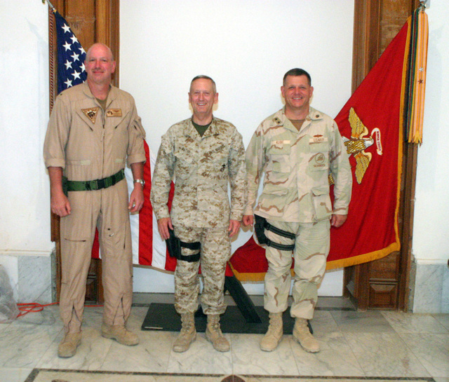 US Navy (USN) Rear Admiral (RDML) (lower half) Kenneth W. Deutch (left), Commander, Combined Task Force (CTF) 57, US Marine Corps (USMC) Major General (MGEN) James N. Mattis (center), Commander, 1ST Marine Division (MAR DIV), and USN Rear Admiral (RADM) (upper half) Charles R. Kubic (right), Commander, Naval Construction Forces Command (NCFC), and Commander, Construction Group (CNSTR GP), 1ST Marine Expeditionary Force (1 MEF), 1ST Marine Division (MAR DIV), take a moment to have their photograph taken inside the 1ST MAR DIV Headquarters (HQ) building on Forward Operating Base (FOB) Blue Diamond, in Ar Ramadi, Iraq (IRQ). The 1ST MAR DIV, in support of Operation IRAQI FREEDOM, is...
