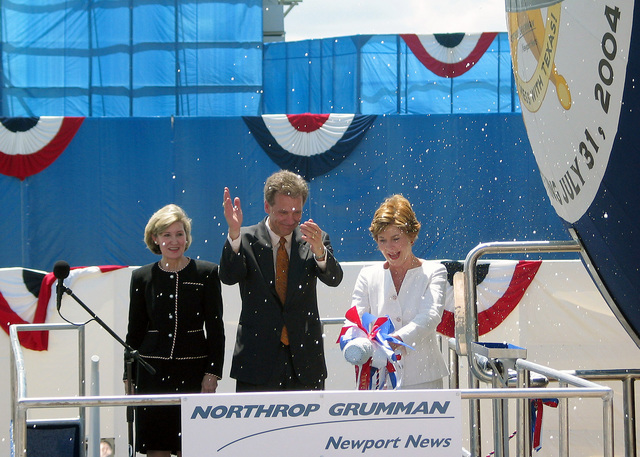 US Senator, The Honorable Kay Bailey Hutchinson (R-TX) (left) and Mr. Tom Shievelbein, President, Northrop Grumman Newport News Shipyard, look on as First Lady Laura Bush smashes a bottle of champagne against the bow of the US Navy (USN) VIRGINIA CLASS: New Attack Submarine, USS TEXAS (SSN 775), during the ships Christening Ceremony, held at the Northrop Grumman Newport News Shipyard, located in Newport News, Virginia (VA)