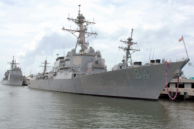 The US Navy (USN) Arleigh Burke Class Destroyer USS BULKELEY (DDG 84) (foreground) and the USN Ticonderoga Class Cruiser USS SAN JACINTO (CG 56) moored at Naval Station (NS) Norfolk, Virginia. BULKELEY adorned with a Hawaiian Lei after returning home from deployment with Carrier Strike Group (CSG) in support of Operation IRAQI FREEDOM