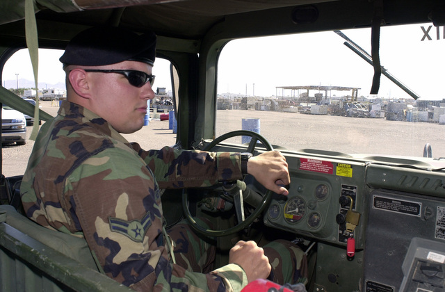 US Air Force (USAF) AIRMAN 1ST Class (A1C) Jerald J Barnes with the 56th Security Forces Squadron (SFS), Luke Air Force Base (AFB) Arizona (AZ), drives a High-Mobility Multipurpose Wheeled Vehicle (HMMWV) during certification for an upcoming deployment