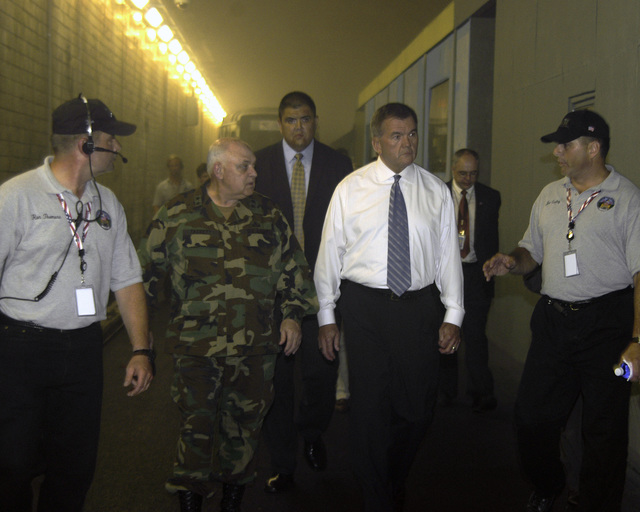 The Honorable Tom Ridge, Office of Homeland Security Secretary, visits The Center for National Response (CNR) at the West Virginia (WV) Memorial Tunnel Project. US Army (USA) Major General (MGEN) Allen E. Tackett, Adjutant General (AG) of the West Virginia National Guard (WVARNG) and West Virginia Congresswoman Shelley Moore Capito, accompanied him. (SUBSTANDARD)