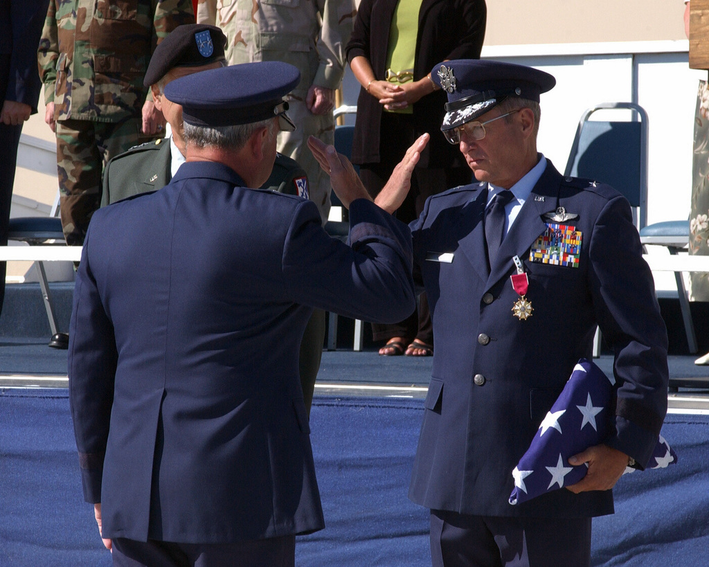 Us Air Force Usaf Brigadier General Bg Michael Hickey And Bg Jared Kennish Salute Each Other After Bg Hickey Presents Bg Kennish With An American Flag That Was Flown Over The 143rd
