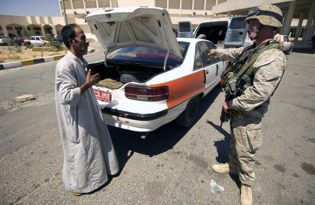 US Marine Corps (USMC) personnel with Sergeant Potter pulls a suspected gasoline smuggler over as he attempts to cross the border into Syria at the Iraqi border checkpoint. The gasoline smugglers build and attach additional tanks into their vehicles so they bring cheaper gas from Iraqi and sell it at a much higher price in Syria