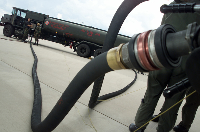 The fuel hoses are laid out from a R11 Aircraft Refueling Tank Truck to a US Air Force (USAF) aircraft being refueled at Davis-Monthan Air Force Base (AFB), Arizona (AZ)