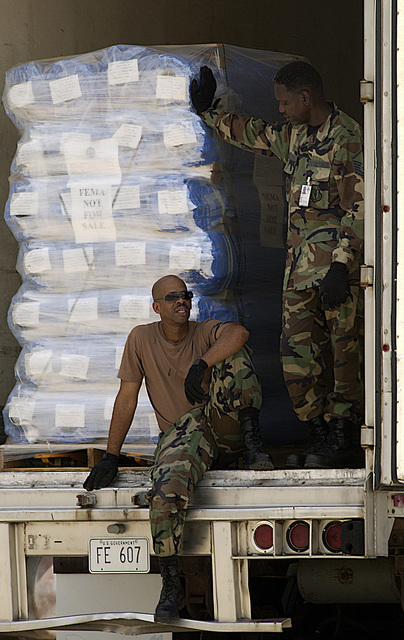 US Air Force (USAF) Airmen from 437th Airlift Squadron (AS), Charleston Air Force Base (AFB), South Carolina (SC), deployed to Dobbins Air Reserve Base (ARB), Georgia (GA), take a break while waiting on the next forklift to move relief supplies off a trailer. They are supporting relief operations conducted by Federal Emergency Management Agency (FEMA) in response to Hurricane Charley victims of Florida (FL)
