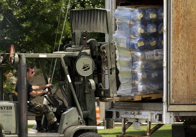 US Air Force (USAF) Airmen from 437th Airlift Squadron (AS), Charleston Air Force Base (AFB), South Carolina (SC), deployed to Dobbins Air Reserve Base (ARB), Georgia (GA), use a Hyster H155xl 15K forklift to move relief supplies from a trailer. They are supporting relief operations conducted by Federal Emergency Management Agency (FEMA) in response to Hurricane Charley victims of Florida (FL)