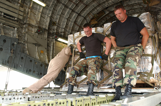 US Air Force (USAF) Airmen from 437th Airlift Squadron (AS), Charleston Air Force Base (AFB), South Carolina (SC), deployed to Dobbins Air Reserve Base (ARB), Georgia (GA), load a pallet of relief supplies onto a USAF C-17A Globemaster III. They are supporting relief operations conducted by Federal Emergency Management Agency (FEMA) in response to Hurricane Charley victims of Florida (FL)