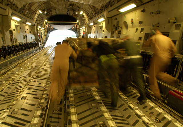 US Air Force (USAF) Airmen from the 621-8 tanker airlift control element (TALCE), McGuire Air Force Base (AFB), New Jersey (NJ), and aircrew members from Charleston AFB, South Carolina (SC), offload a USAF C-17A Globemaster III cargo aircraft providing support for Hurricane Charley relief efforts in Lakeland, Florida (FL). Lakeland Regional Airfield is the center of relief operations in Florida for the Federal Emergency Management Agency (FEMA). The USAF is providing support by transporting tons of equipment, personnel, and supplies via air, expediting the delivery of the needed supplies